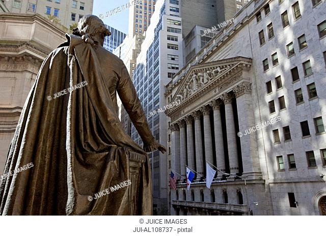 New York Stock Exchange as seen from Wall Street with statue of George Washington in foreground, New York City, USA