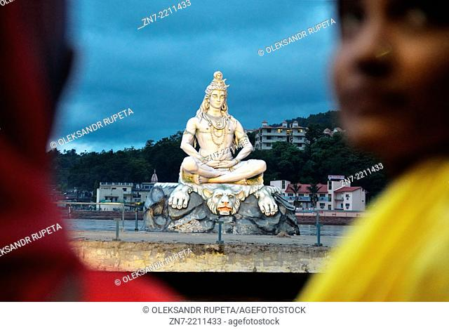 Statue of Lord Shiva illuminated at night during the Evening Aarti Ceremony, Rishikesh