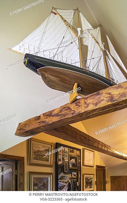 Wooden scale model of the Bluenose schooner displayed on a wooden beam on the upper floor inside an old circa 1850 Canadiana cottage style home