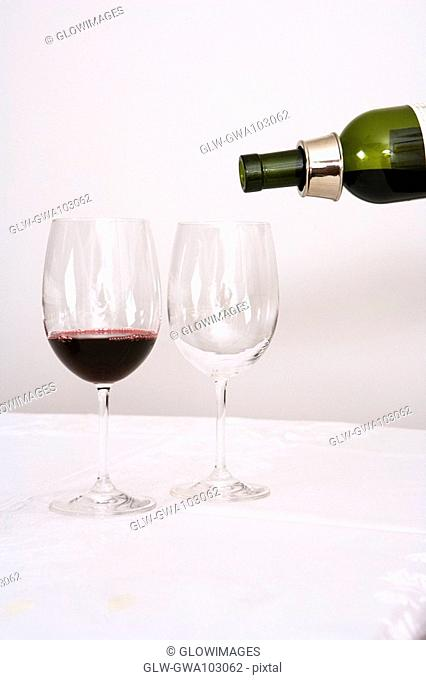 Wine being poured into wine glasses