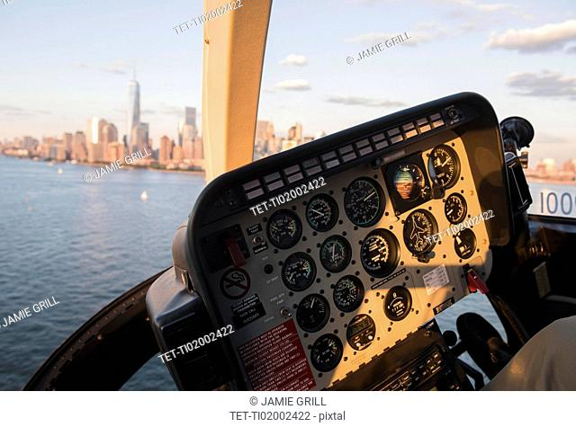 Cockpit in helicopter and Manhattan skyline
