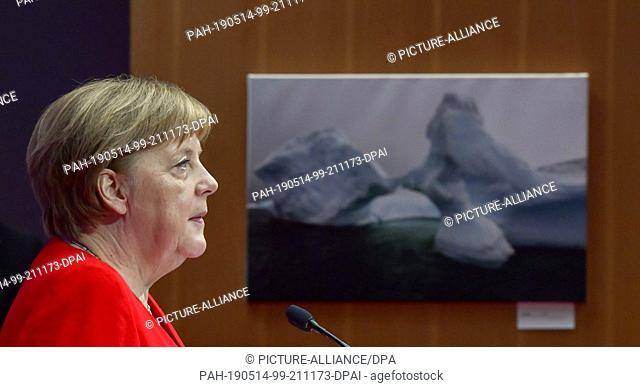 14 May 2019, Berlin: Chancellor Angela Merkel (CDU) speaks at the 10th Petersberg Climate Dialogue, in the background you can see a photo of an iceberg