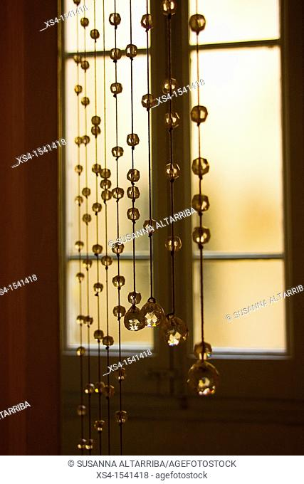 Crystal beaded curtain in front of a window