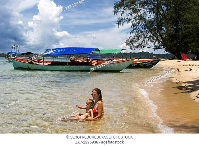 Beach on the island of Koh Russei. Koh Russei, also named Koh Russey or Bamboo Island is a green, gilt-edged crescent, resting on emerald or blue water