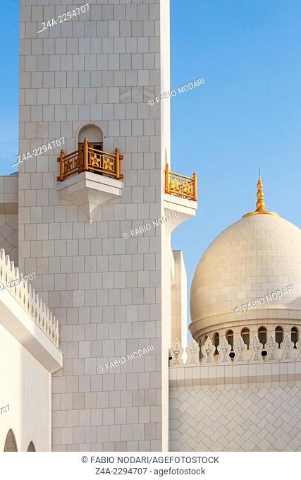 Domes of the Sheikh Zayed Grand Mosque at sunset
