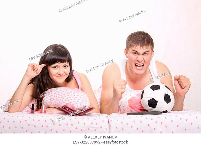 Husband, according to his wife crazy with football