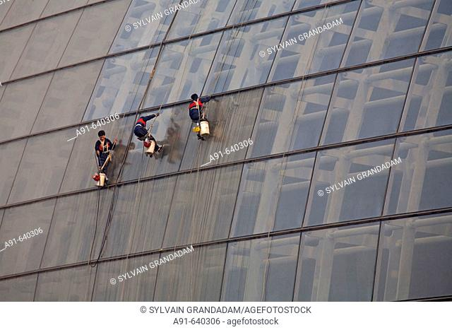 Men at work cleaning the glass roof, new opera house near Tian Nen Men square , opening 2008 (Architect Paul Andreu from France). City of Beijing
