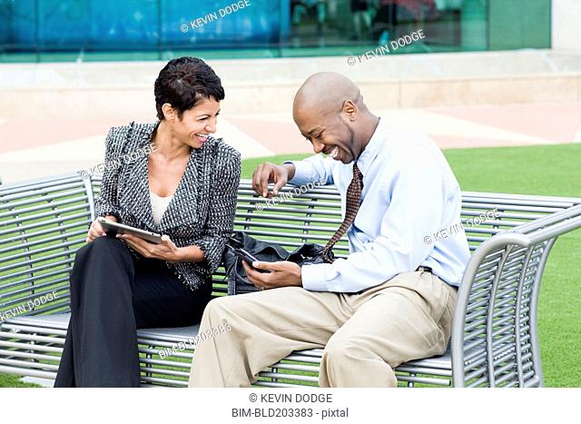Business people laughing together outdoors