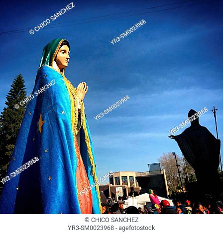 The image of Our Lady of Guadalupe and the monument to Pope John Paul II during the annual pilgrimage to the Our Lady of Guadalupe Basilica in Mexico City