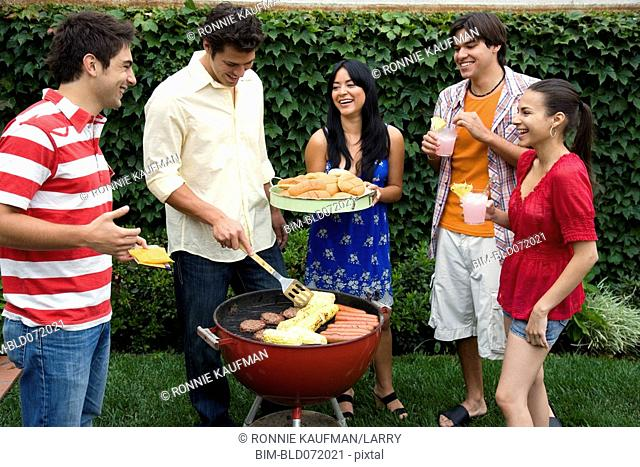 Hispanic friends having barbecue