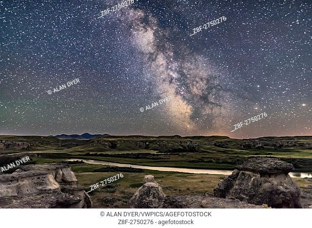 The summer Milky Way and galactic centre area to the south over the Milk River in Alberta and the Sweetgrass Hills of Montana