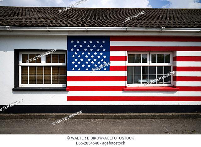 Ireland, County Offaly, Moneygall, house painted with US flags for visit by US President Barack Obama