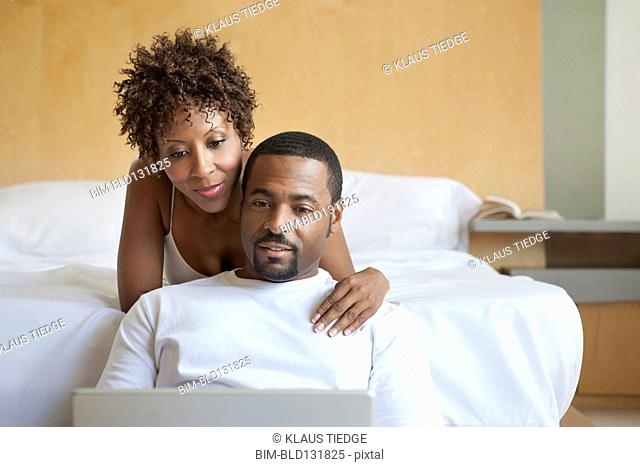 African American couple using laptop