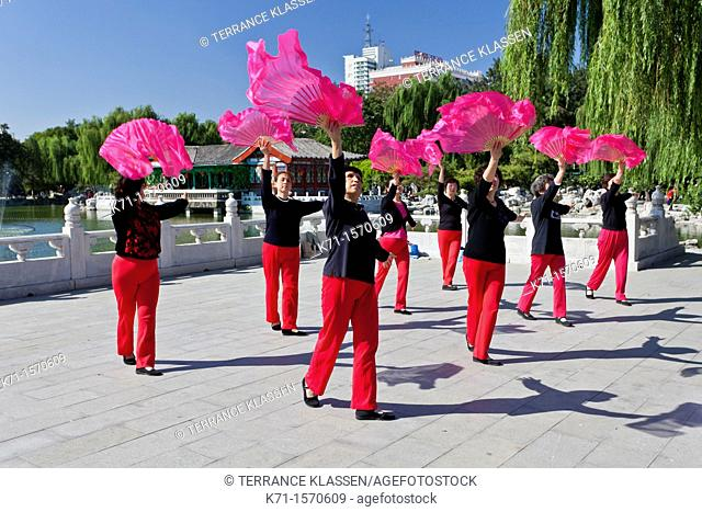 A colorful ladies dance group rehearsing in Grandview Park, Beijing, China