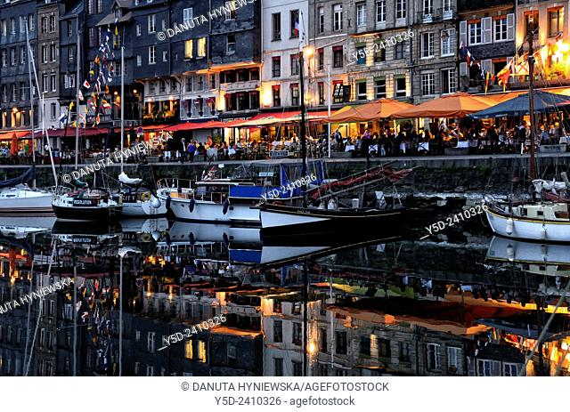 restaurants full of people, evening at Vieux bassin, Honfleur, Normandy, France