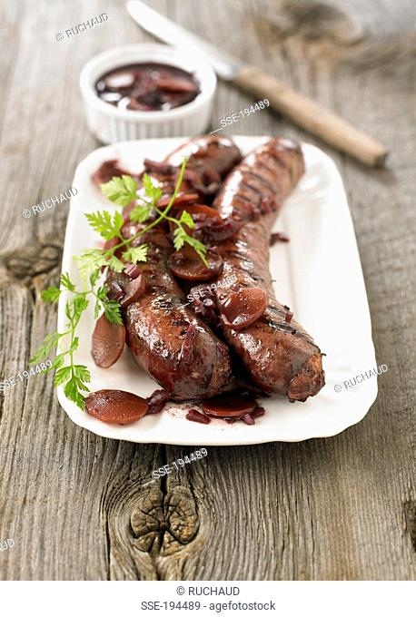 Grilled sausages from Toulouse ,wine,carrot and onion sauce