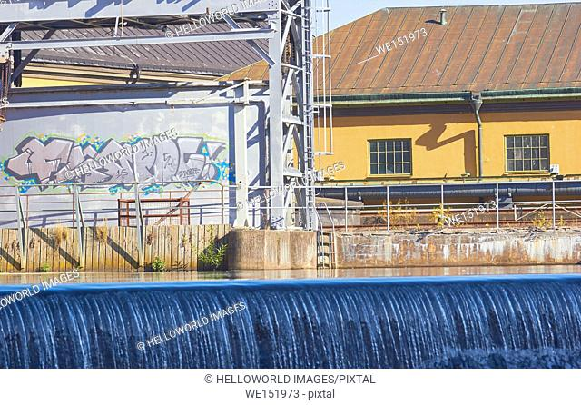 Scene from Norrkoping old industrial landscape with waterfall, Norrkoping, Ostergotland, Sweden, Scandinavia