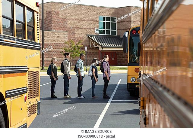 High school students queuing for school bus