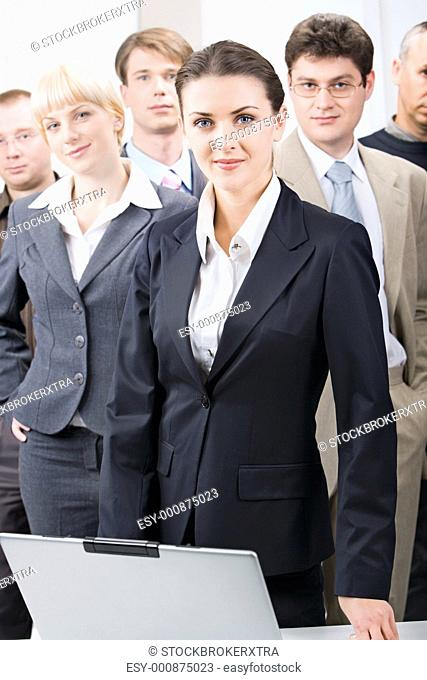 Business team with a businesswoman leading it