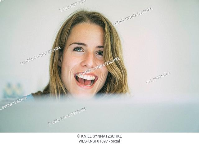 Happy young woman with laptop