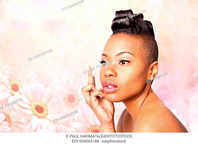 Face of beautiful woman applying facial moisturizer exfoliating anti wrinkle aging cream under eyes, skincare concept, on pink flowers