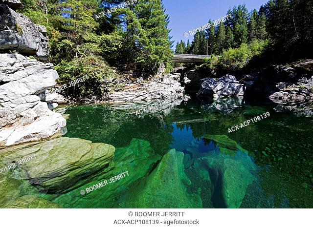 The crystal clear Heber River joins in with the Gold River and is a popular summertime venue for swimmers. Gold River, Vancouver Island, British Columbia