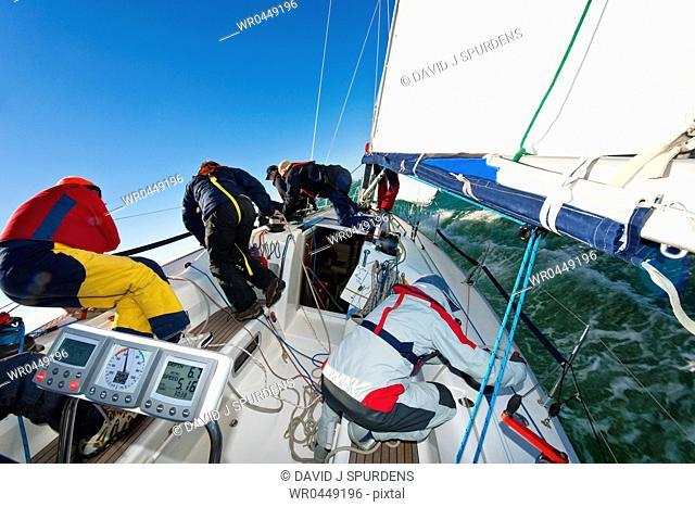 A yacht crew racing an ocean going yacht