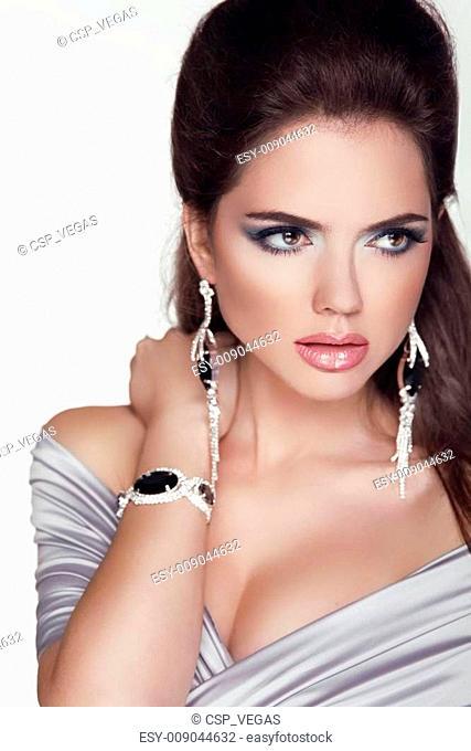 Beautiful woman with jewelry fashion accessories. Make-up. Beauty Girl portrait. Professional studio photo