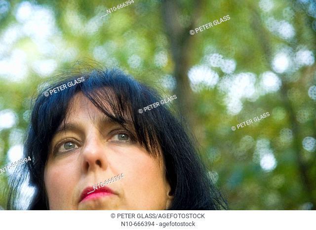 Woman posing in her backyard