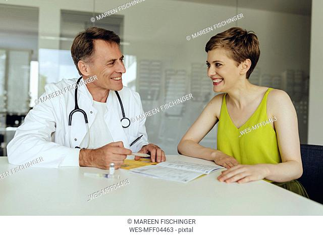 Woman discussing teatment with her doctor