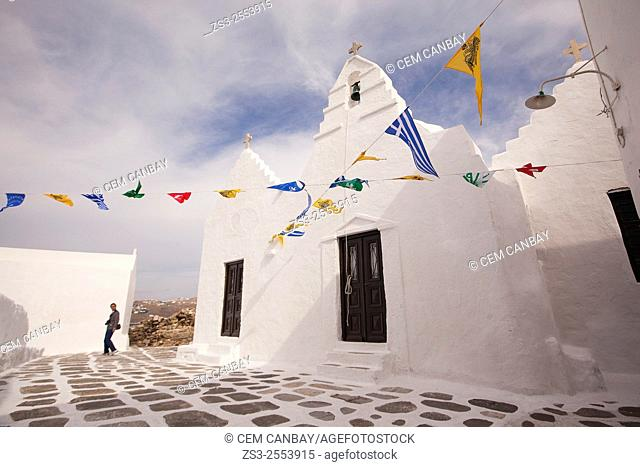 Tourist in front of the Chapel of the Paraportiani Church, Mykonos, Cyclades Islands, Greek Islands, Greece, Europe