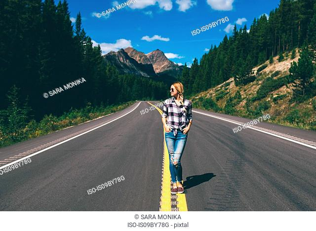 Woman in middle of road, Jasper, Canada