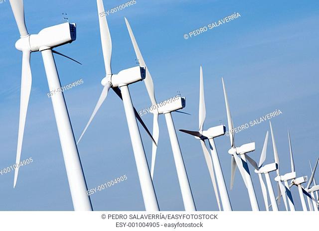 group aligned modern windmills for renewable electric energy production, Pozuelo de Aragon, Saragossa province, Aragon, Spain