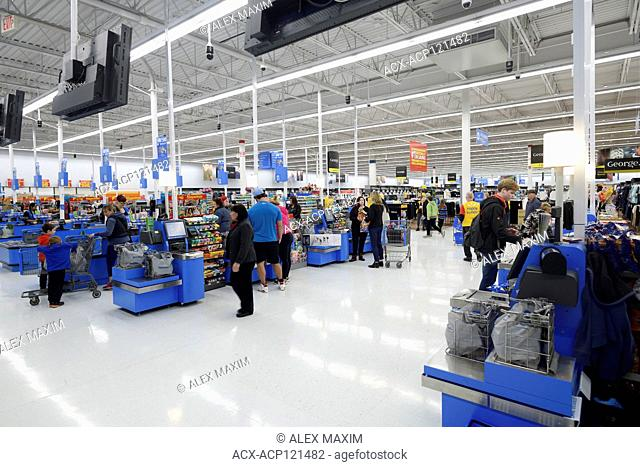 Self-checkout counters, self-service checkout section at Walmart store. British Columbia, Canada 2017