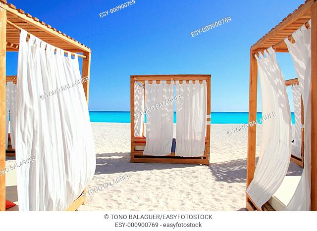 Caribbean gazebo beds in tropical beach sand tranquil vacations