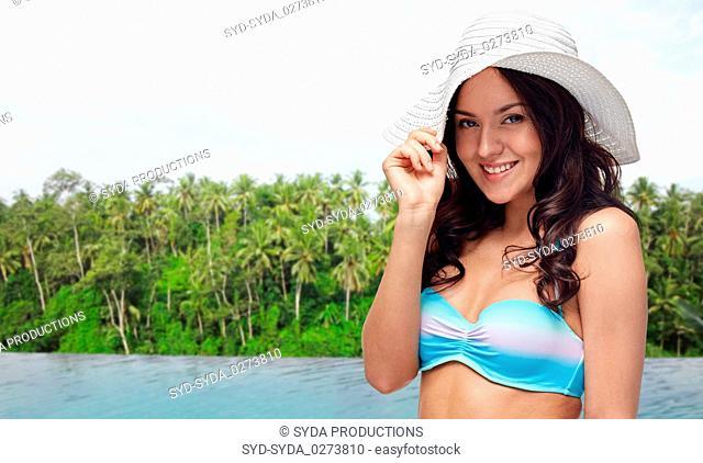 happy woman over infinity edge pool in sri lanka
