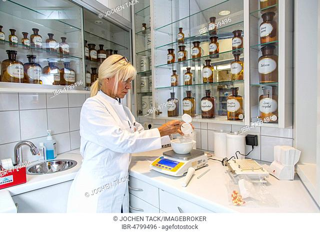 Pharmacy, pharmacist produces an individual medication, in the laboratory, according to medical instructions, Germany