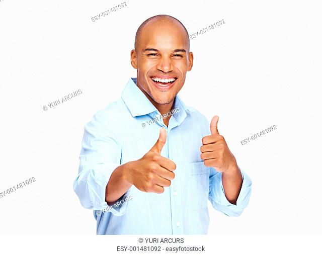 Portrait of a happy male business executive gesturing thumbs up sign over white background