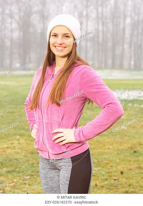 Portrait of smiling fitness women , outdoor activity , winter season