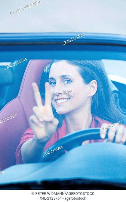 young beautiful woman in cabrio, roadster (model-released)