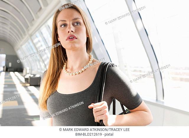 Caucasian businesswoman standing in lobby