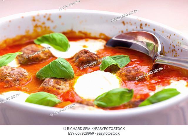 baked Bolognese balls with tomato, basil and fresh bull mozzarella
