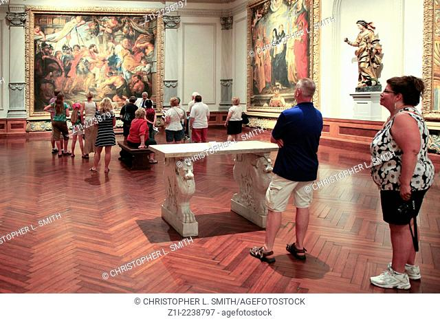 People enjoying a guided tour of the art galleries at the Ringling Museum in Sarasota FL