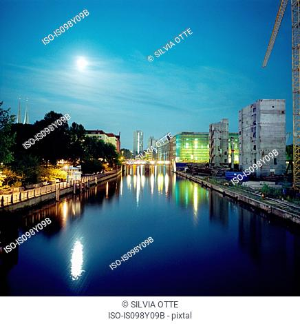 Canal in moonlight at night, Berlin, Germany