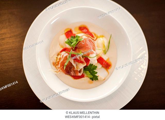 Serrano ham, Parma ham, Red pepper, Artichoke mousse on plate