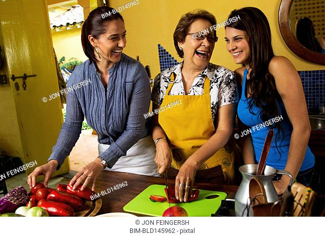 Hispanic family cooking together