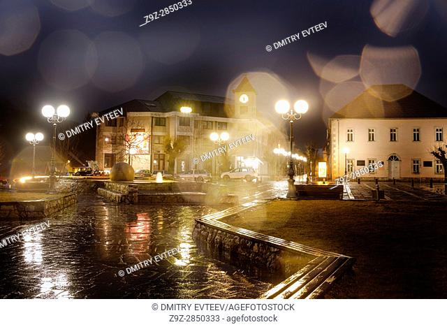 Rain drops in nasty wheather on central square with clock tower, Kolasin, Montenegro