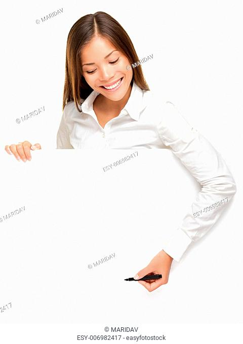 Woman writing on whiteboard sign from above. Woman holding pen smiling, drawing or writing with copy space for text. Beautiful mixed race Asian / Caucasian...