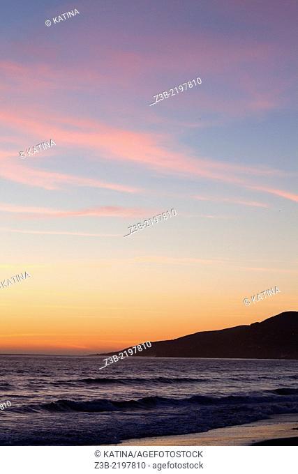 Brilliantly colored sunset in Santa Monica, California, USA