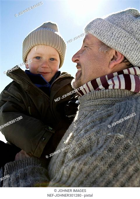 Portrait of a grandfather with his grandson